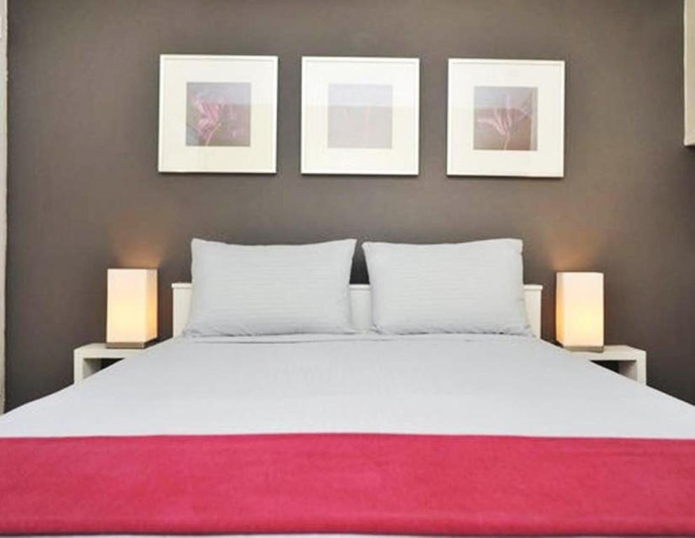 Cama o camas de una habitación en #1Midtown Manhattan Loft Apartment