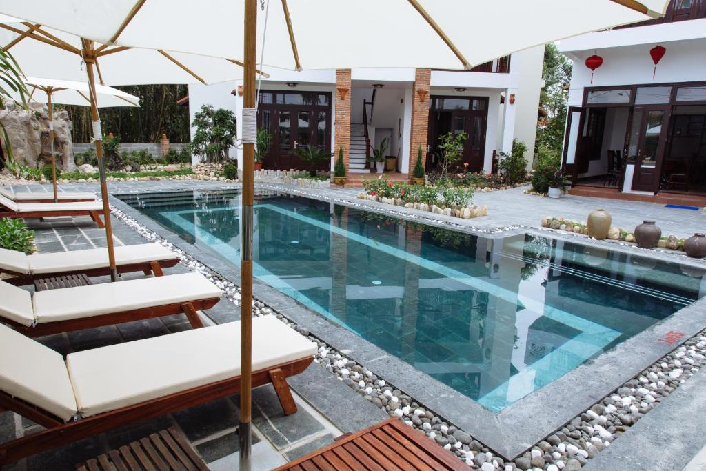 The swimming pool at or near Hoi An Golden Rice Villa