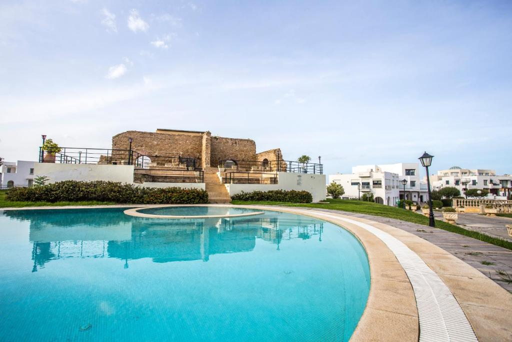 The swimming pool at or near Golden Tulip Carthage Residences