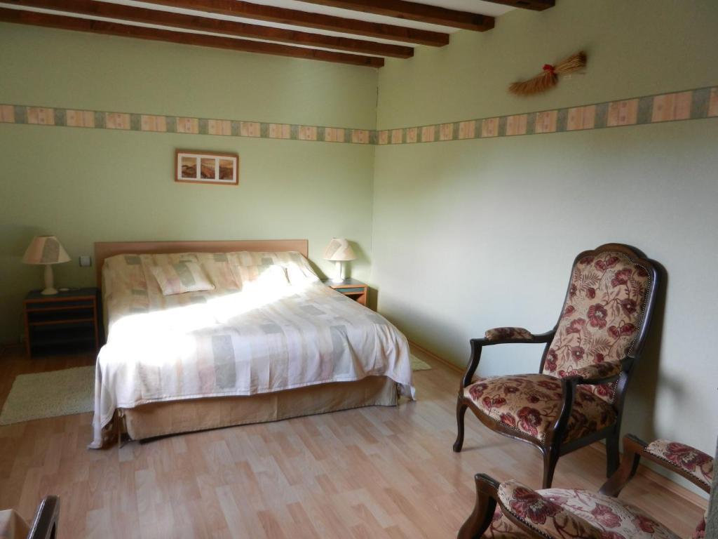 Un ou plusieurs lits dans un hébergement de l'établissement Chambres d'hôtes Chez Dany