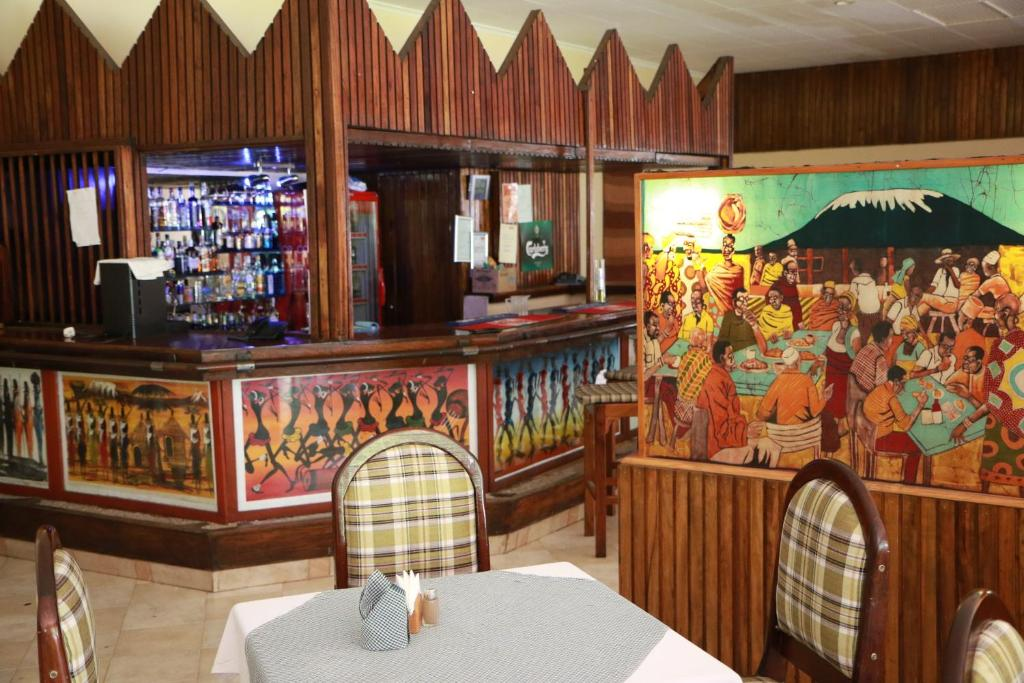 The lounge or bar area at Equator Hotel