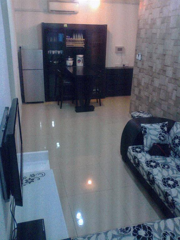 A Television And Or Entertainment Centre At Cyber City 2 Serviced Apartment