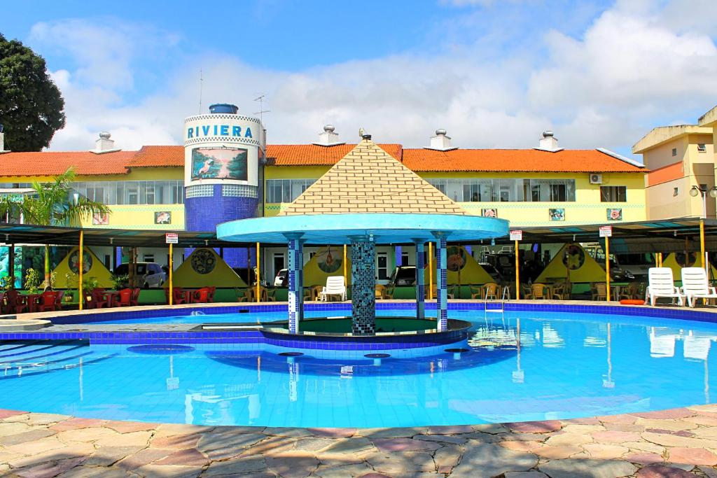 The swimming pool at or near Hotel Riviera D'Amazonia