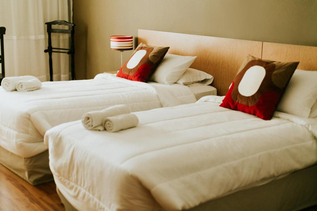 A bed or beds in a room at O-Baires