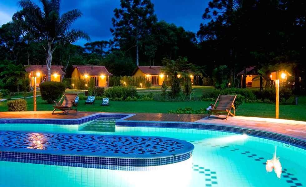 The swimming pool at or near Pousada Villa Acauã