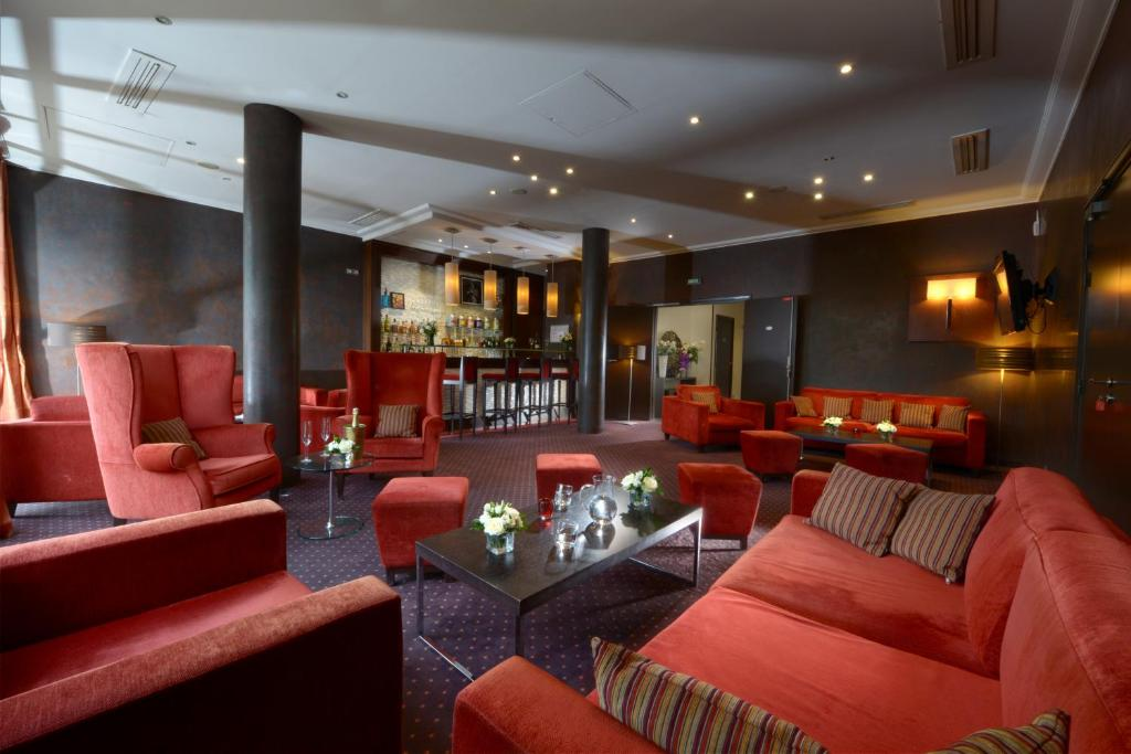 The lounge or bar area at Hotel de Berny