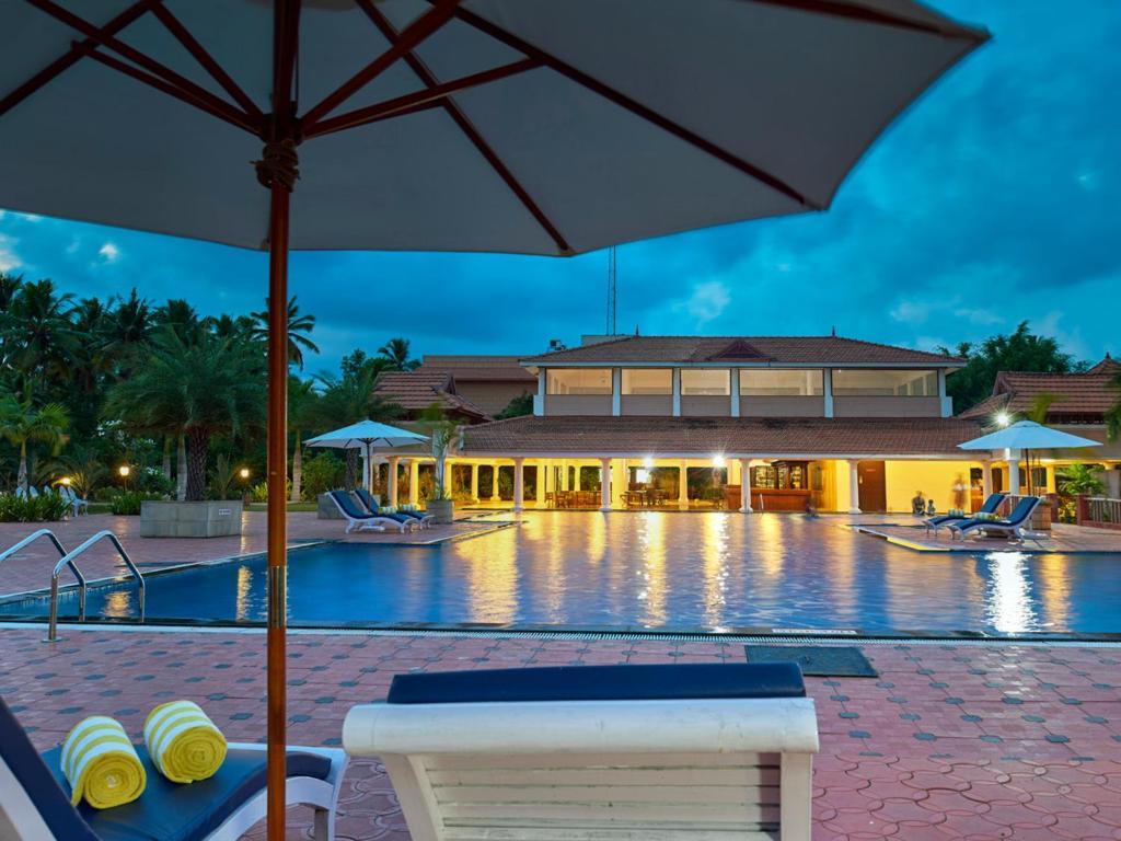 Resort club mahindra poovar p v r india - Club mahindra kandaghat swimming pool ...