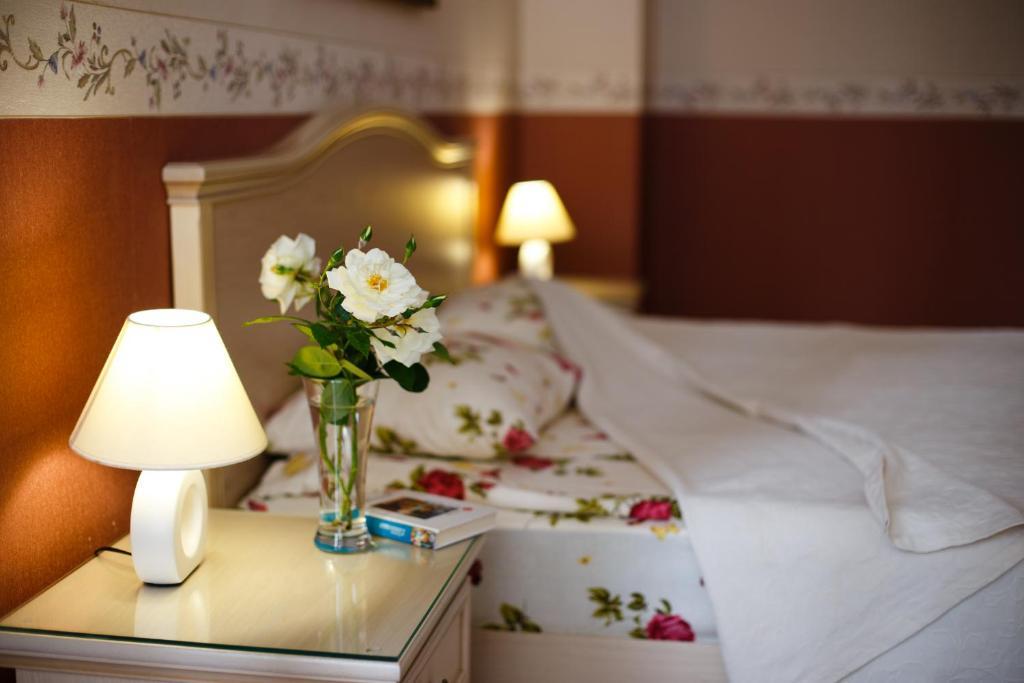 Cama o camas de una habitación en Sparta Hotel