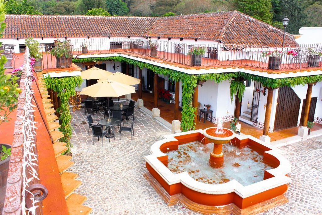 Un patio o zona al aire libre en Villas de la Ermita