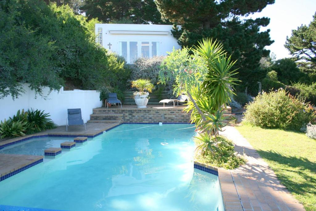 The swimming pool at or near Oceangolf Guest House