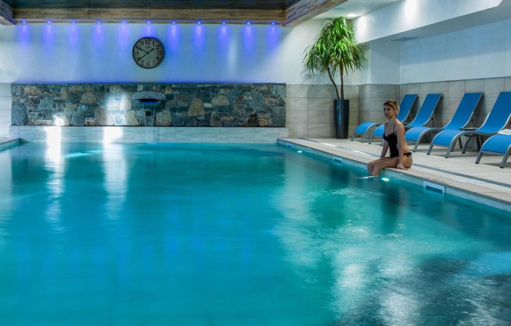 The swimming pool at or near CGH Résidences & Spas Les Chalets De Laÿssia
