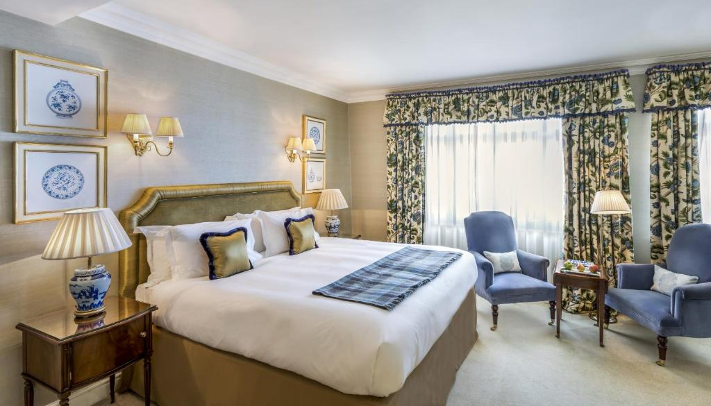 A bed or beds in a room at The Stafford London