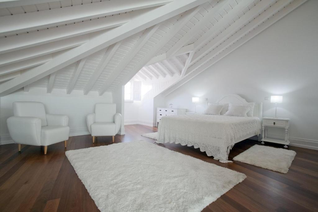 Un ou plusieurs lits dans un hébergement de l'établissement Mercearia da Vila