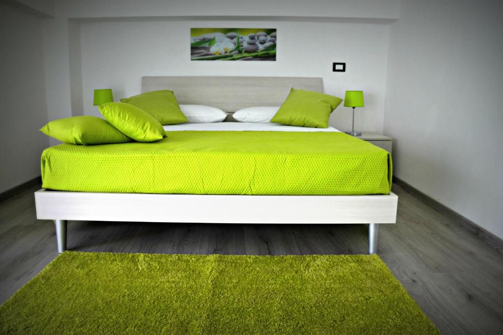 A bed or beds in a room at Naxos Apartments