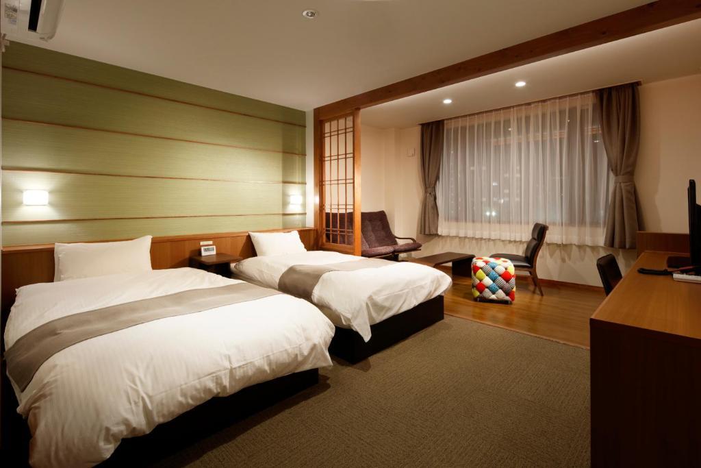 ポイント1.温かみのある明るい客室