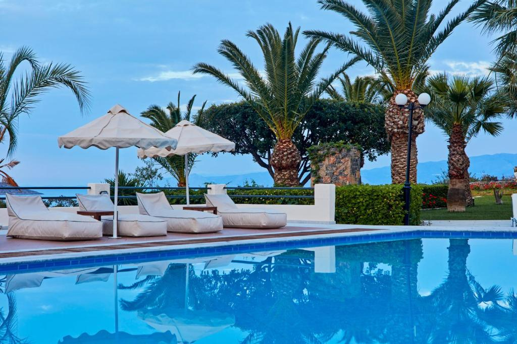 Favori Elounda Palm Hotel, Greece - Booking.com AC24