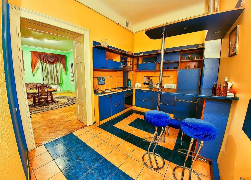 A kitchen or kitchenette at Apartments on Valova 25