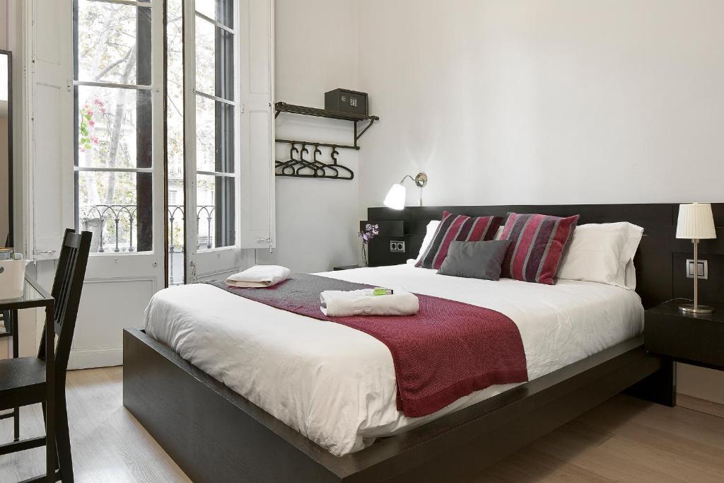 Кровать или кровати в номере BruStar Gotic