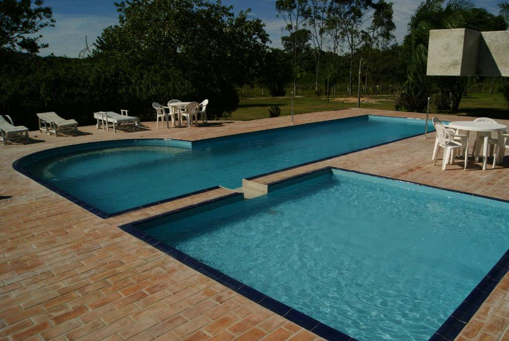 The swimming pool at or near Pousada Canto do Bambu