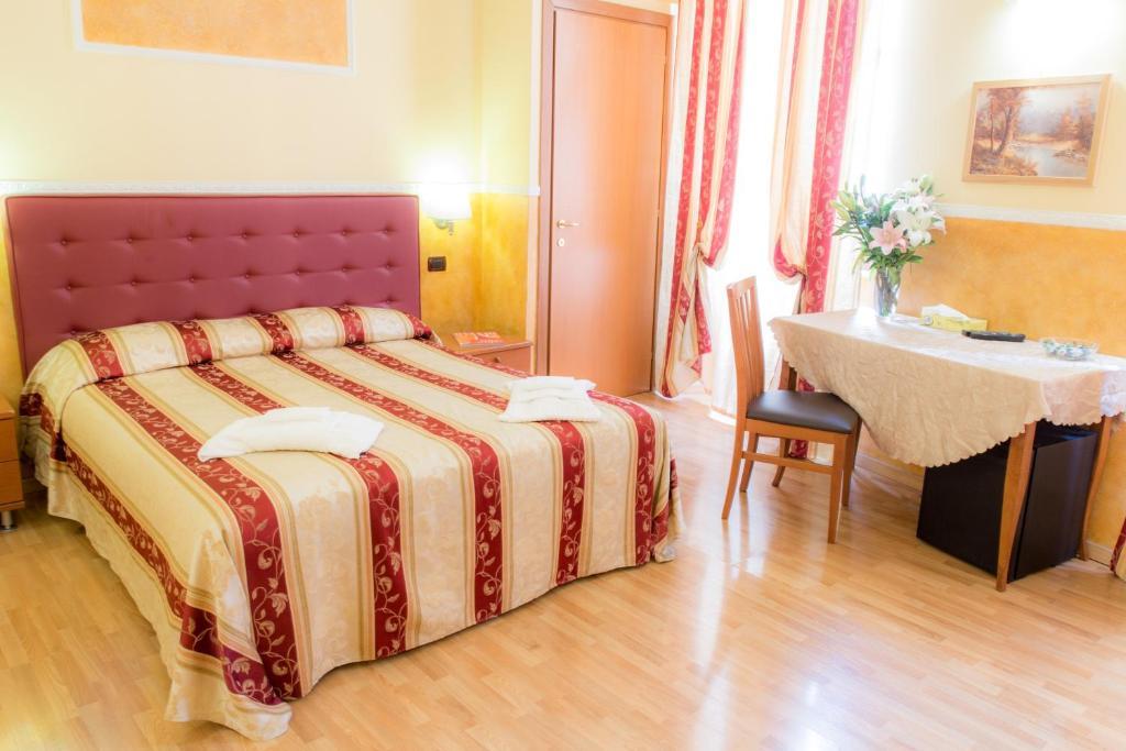 Un ou plusieurs lits dans un hébergement de l'établissement Residenza Ki