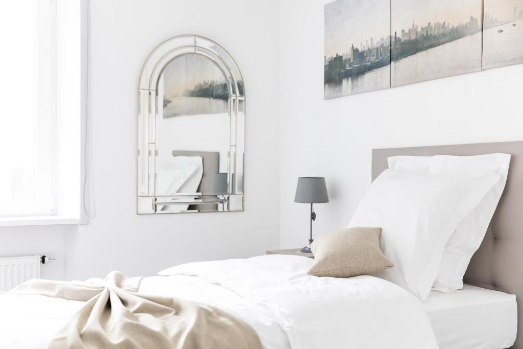 Katil atau katil-katil dalam bilik di Aparthotel Italia