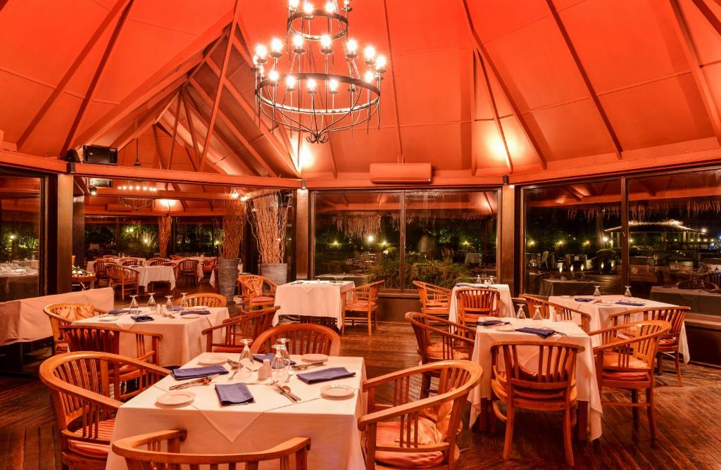Banyan Restaurant and Sunset Restaurant serve international cuisine. The resort's several bars offer cocktails and beautiful beach views.