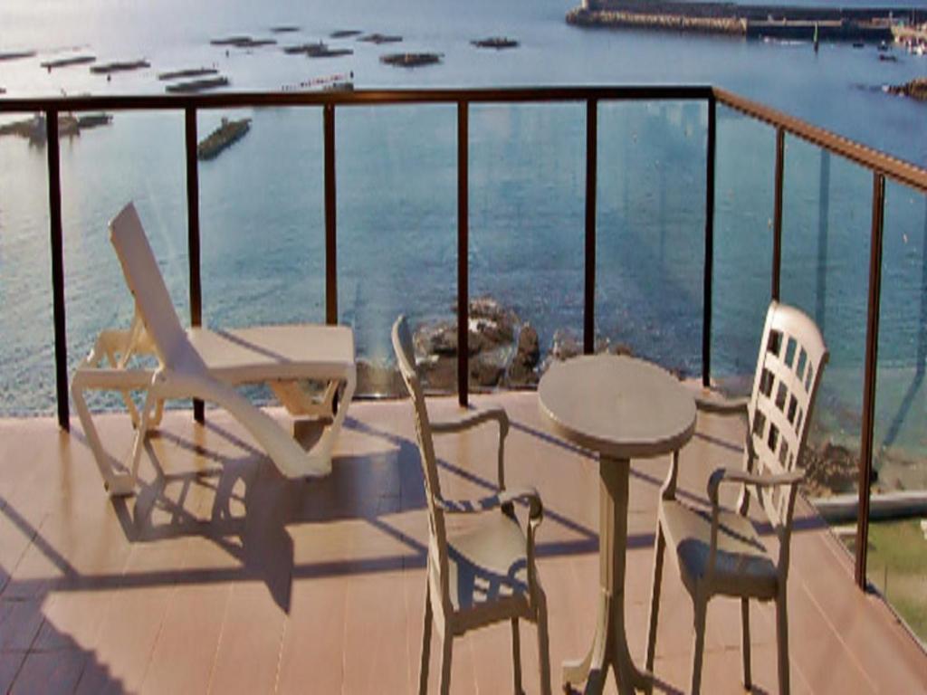 Apartamentos Turísticos Playa de Osmo foto