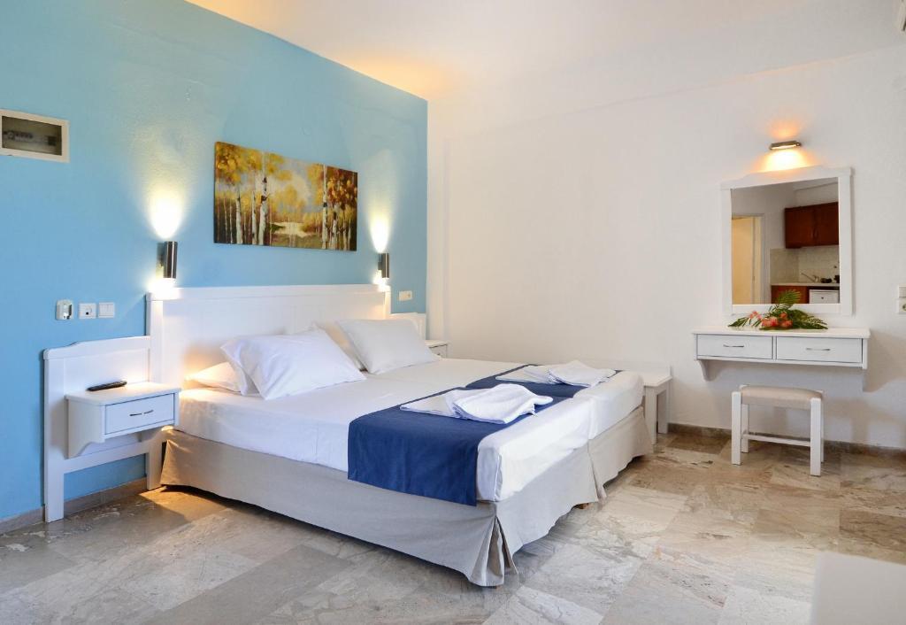 Ένα ή περισσότερα κρεβάτια σε δωμάτιο στο Hotel Korali