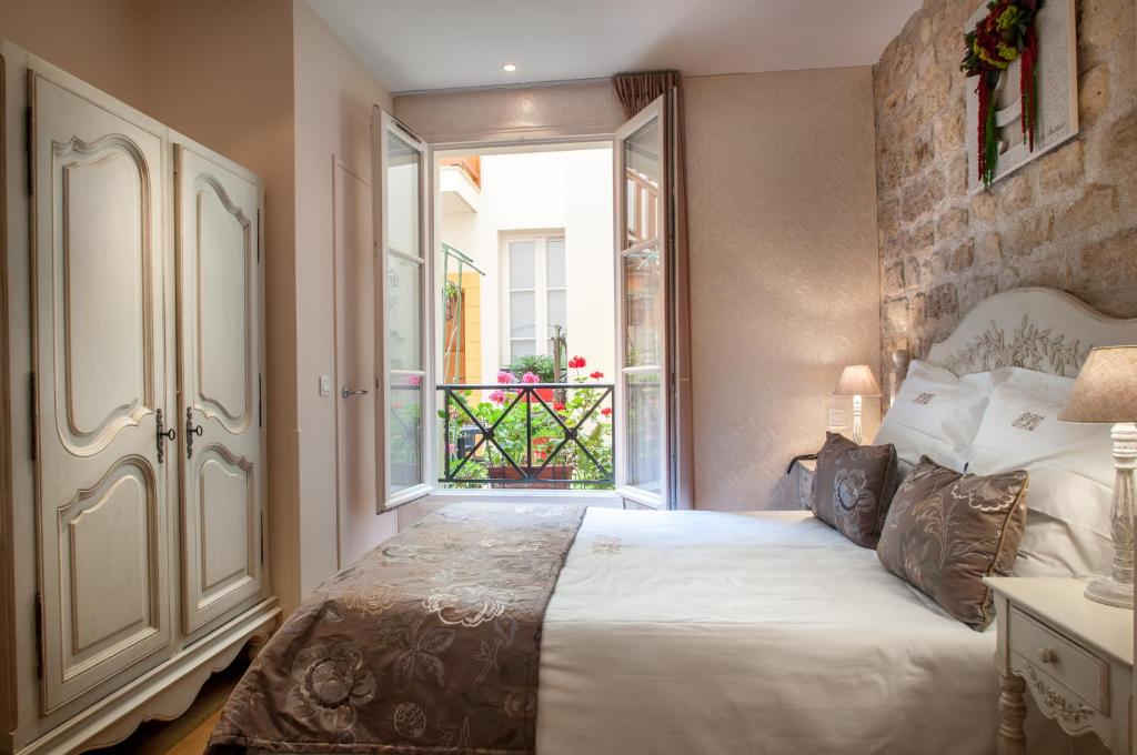 A room at Hôtel Résidence Quintinie Square