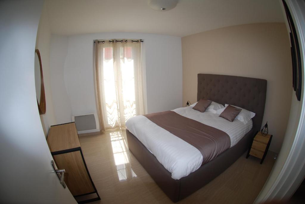 Ein Bett oder Betten in einem Zimmer der Unterkunft Havre de paix en plein centre ville