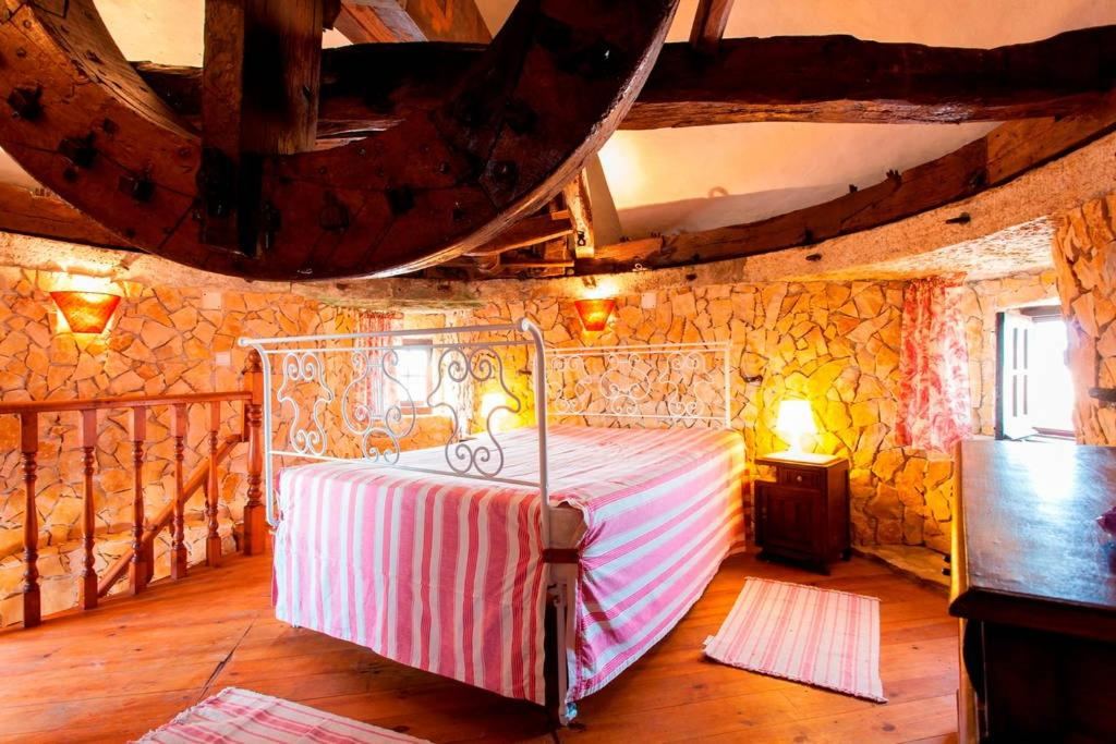 A bunk bed or bunk beds in a room at Moinho da Camila