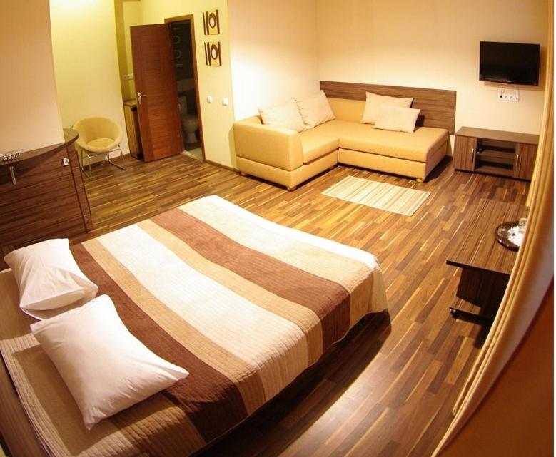 A bed or beds in a room at Hotel Darnitskiy
