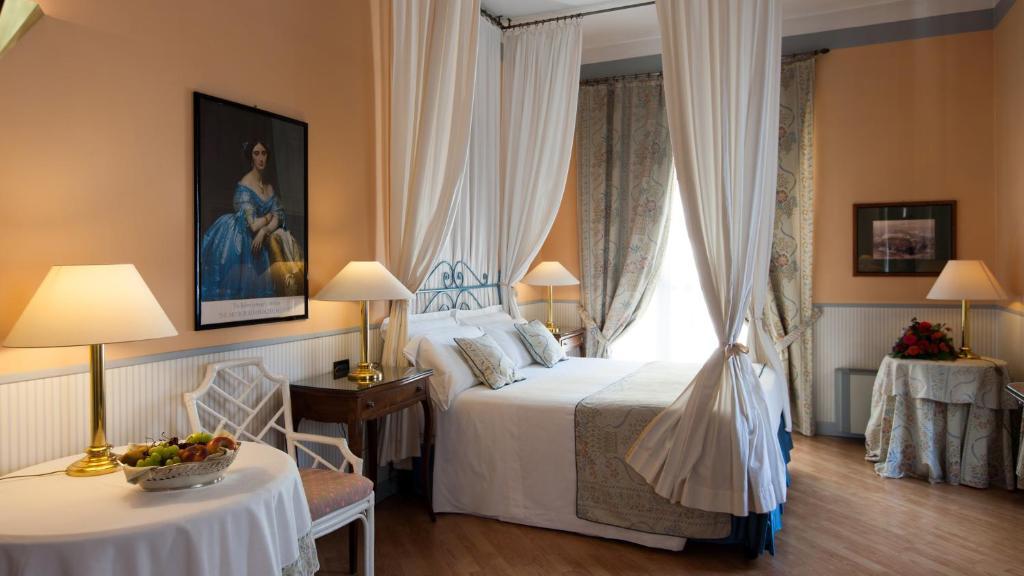 Letto o letti in una camera di Hotel Victoria