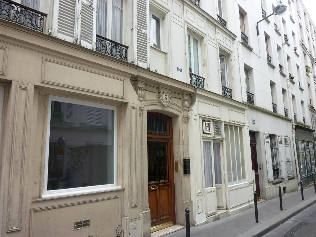 Apartment rue de belfort paris france for Appart hotel belfort