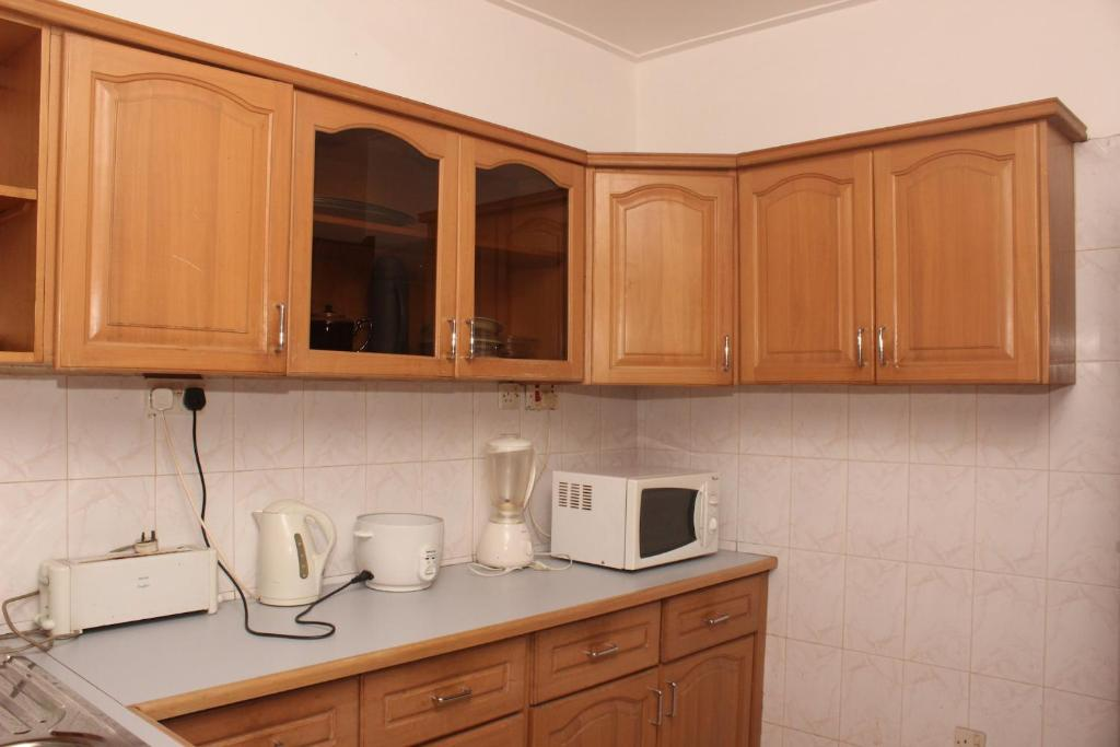 Suaf home lodge ghana baatsona for Kitchen cabinets ghana