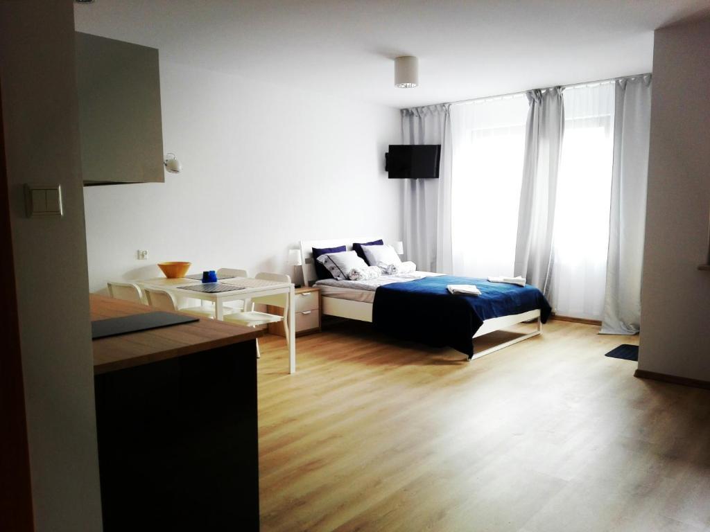 Cama o camas de una habitación en Summertime Gdańsk Jelitkowski Dwór