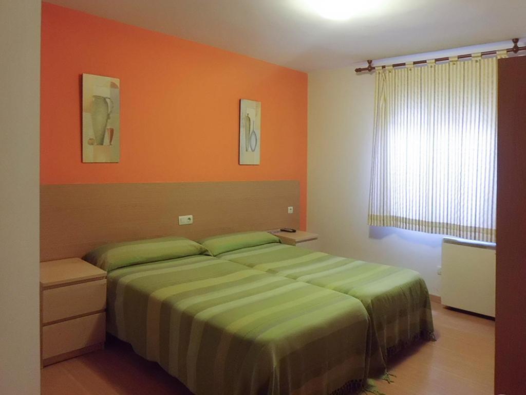Cama o camas de una habitación en Hostal Caracas