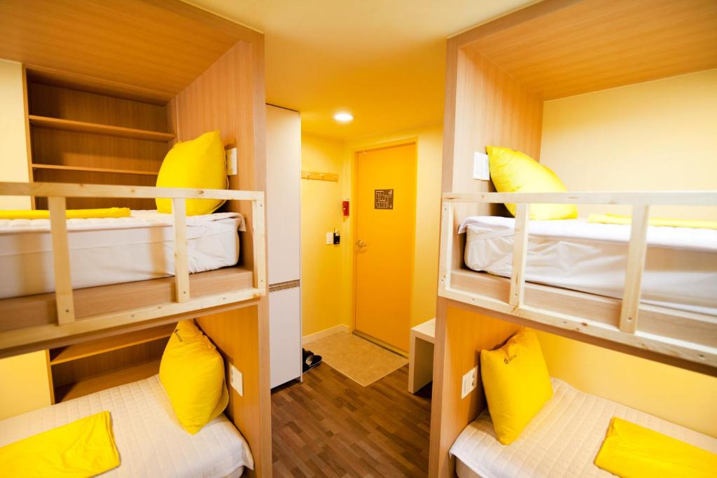 A bunk bed or bunk beds in a room at 24 Guesthouse Seoul Jamsil