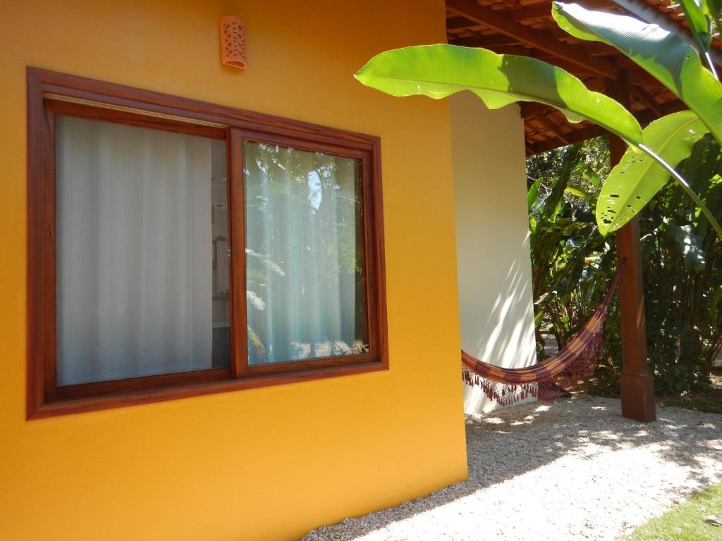 A porch or other outdoor area at Pé Na Areia Itamambuca
