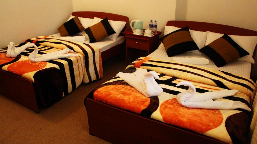A bed or beds in a room at G S P Cottage