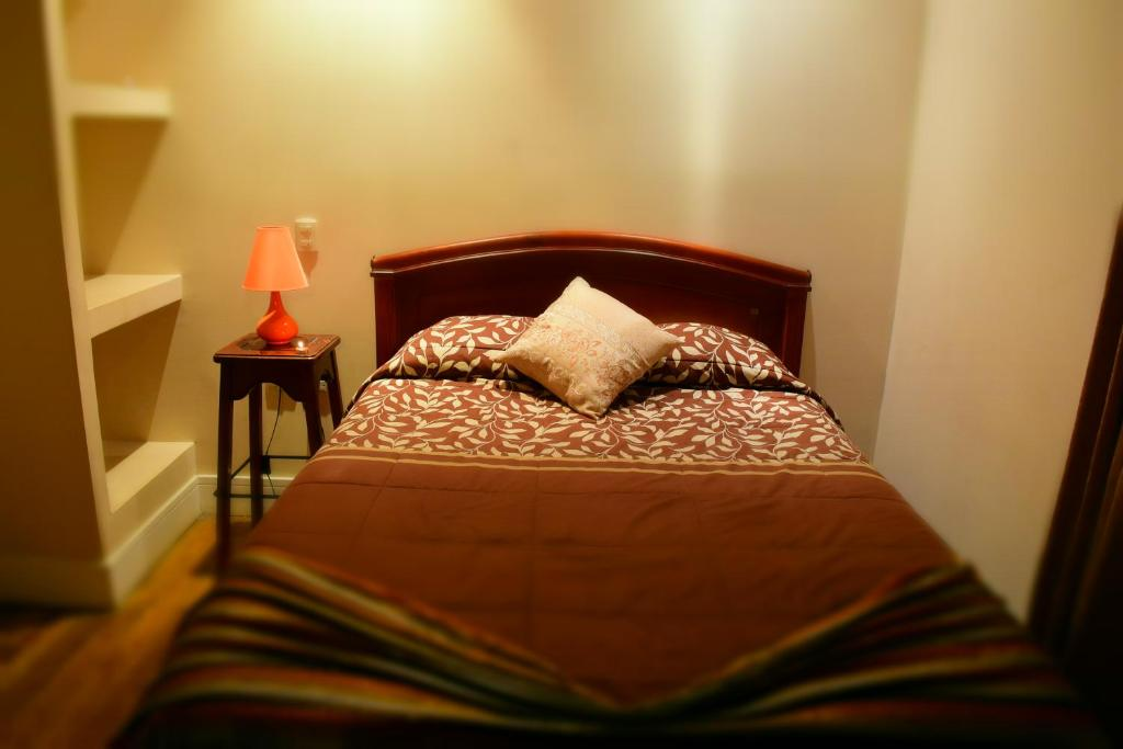 A bed or beds in a room at Hostal Villa del Rosario