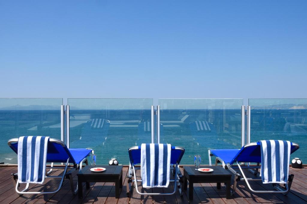 A balcony or terrace at Poseidon Athens Hotel