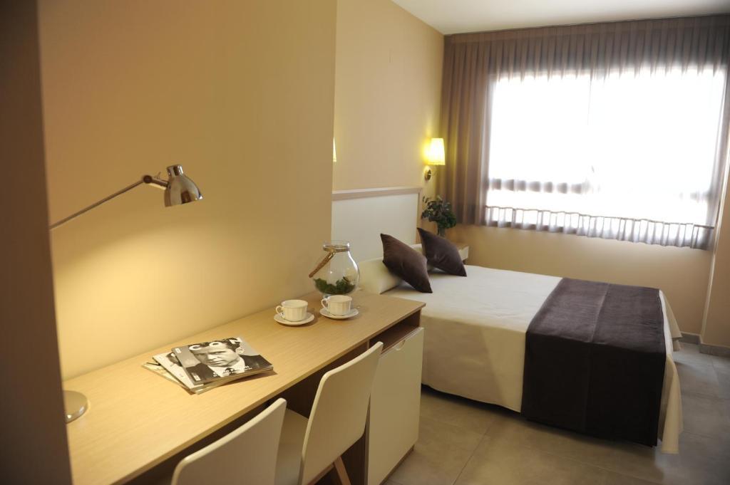 A bed or beds in a room at La City Mercado