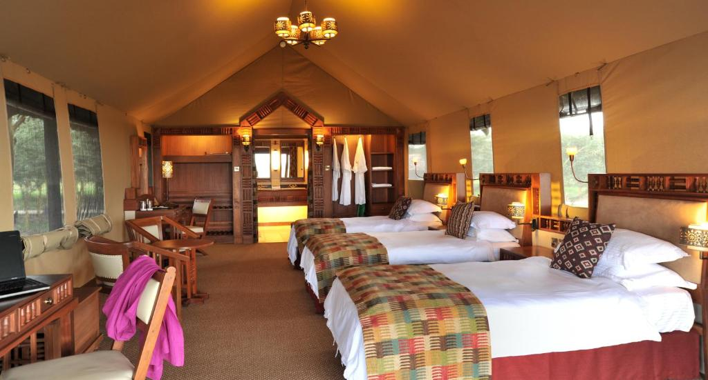 quality design 9d8aa d3763 A bed or beds in a room at Sweetwaters Serena Camp
