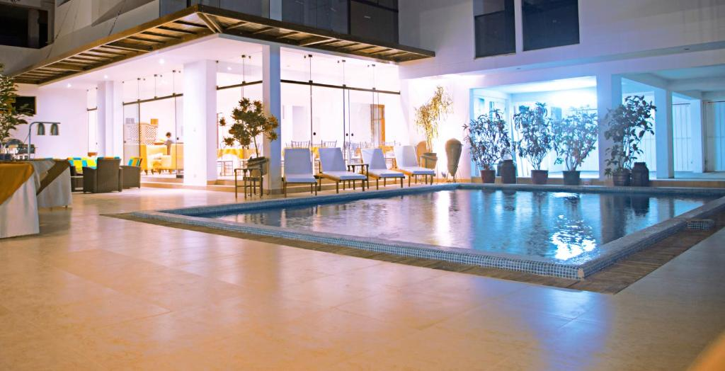 The swimming pool at or near Mc Hotel