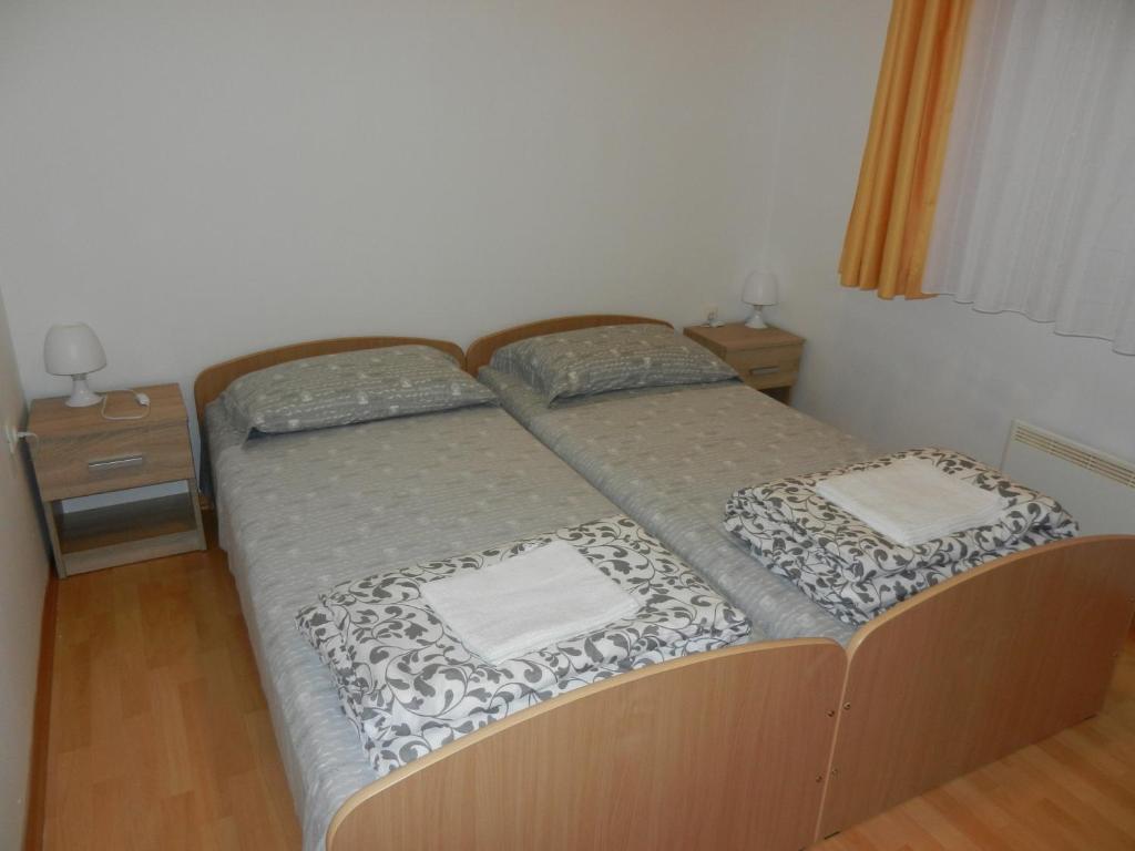 Postelja oz. postelje v sobi nastanitve Apartment Riba