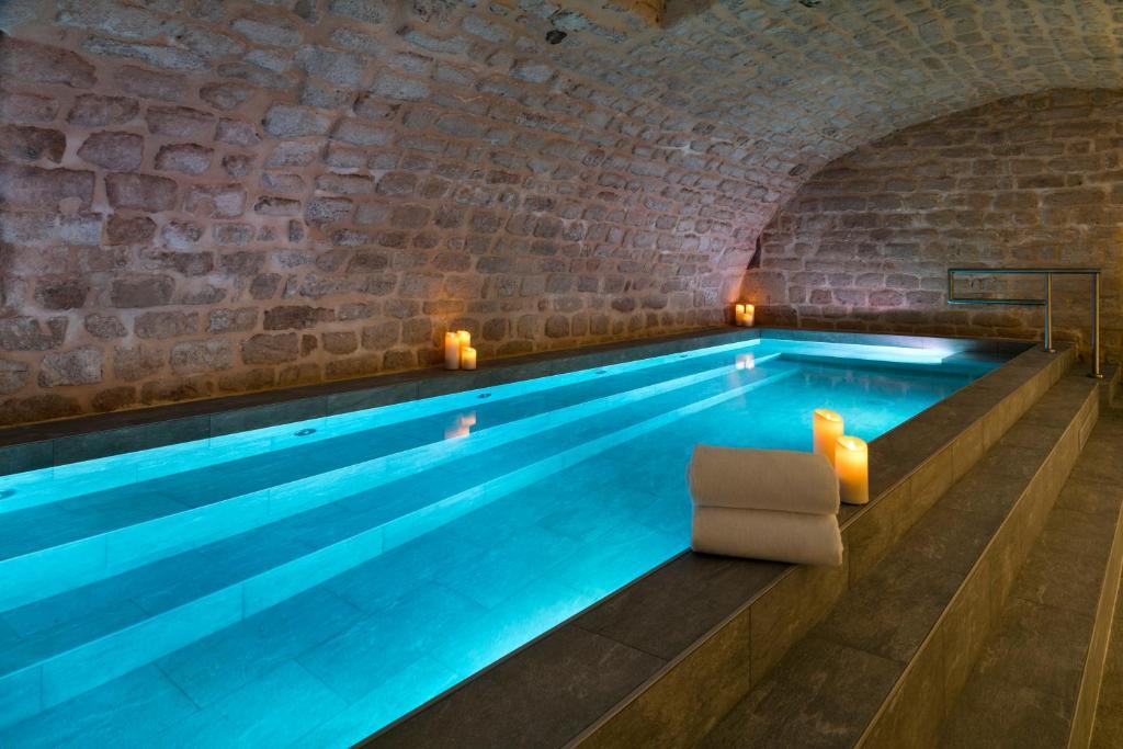 The swimming pool at or near Hôtel Square Louvois