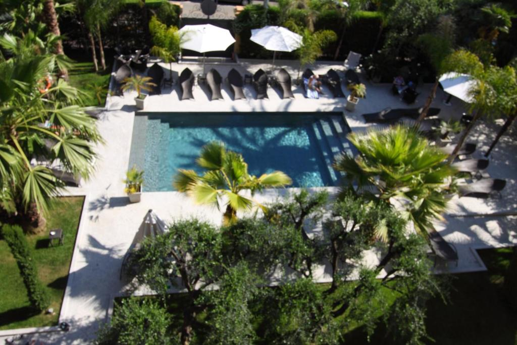 The swimming pool at or near Golden Tulip Cannes Hotel de Paris