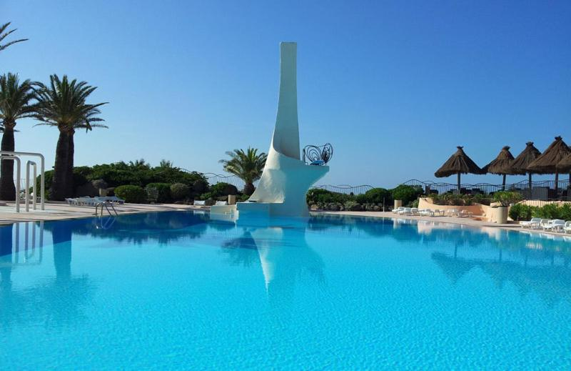The swimming pool at or near Residence port la galere