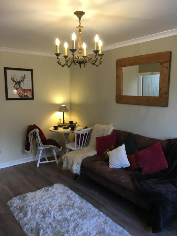 A seating area at 123v Tillicoultry Holiday let